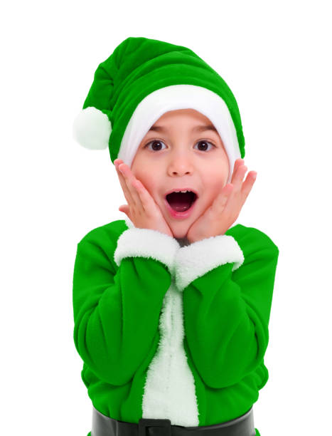 Little boy in green Santa Claus costume stock photo
