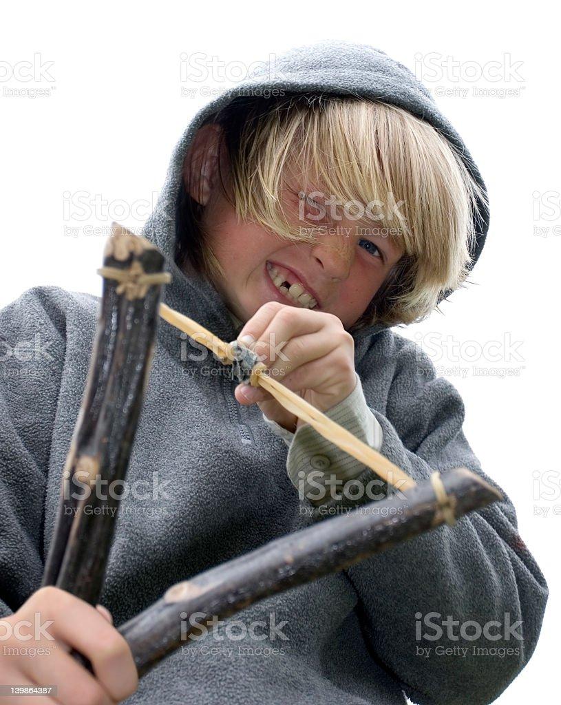 Little boy in hoody holding slingshot stock photo