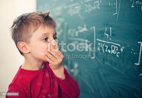istock Little boy in math class overwhelmed by the math formula 531869550
