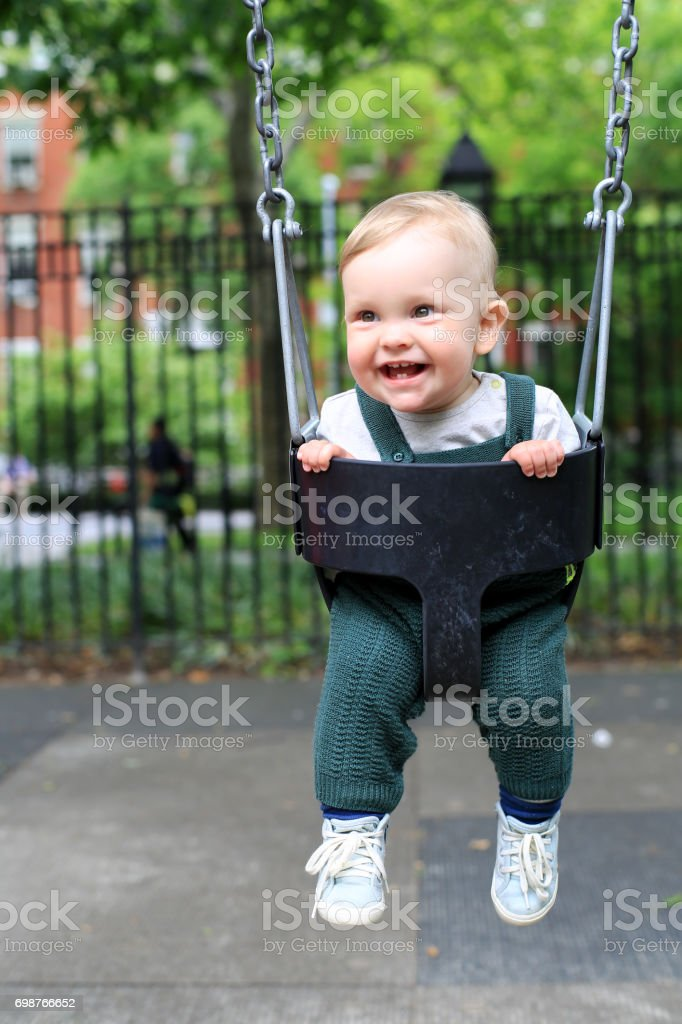 Little boy in overalls stock photo