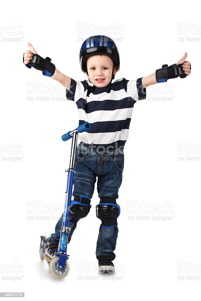 Little boy in protection helmet and knee and arm ruffles stock photo