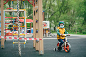 Child riding past playground closed due to an infectious disease pandemic