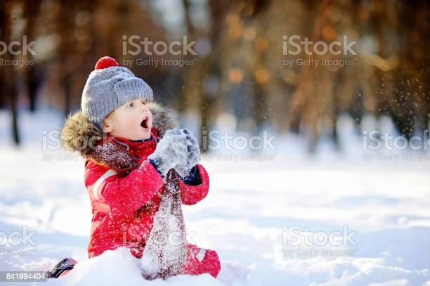 Little boy in red winter clothes having fun with snow picture id841994404?b=1&k=6&m=841994404&s=612x612&h=pgmkdk7uiupxnh80r76rlejwvowng1nfhqcn8f5ou0e=