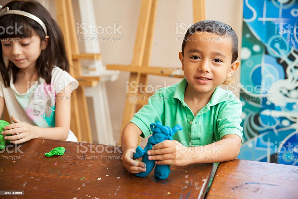 Little boy in sculpture class stock photo