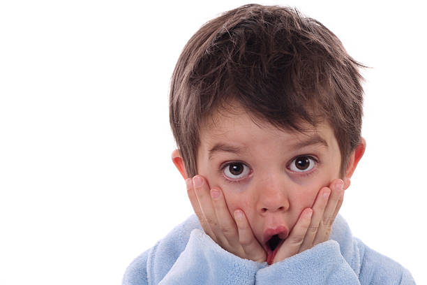 Little boy in shock, looking at the camera stock photo