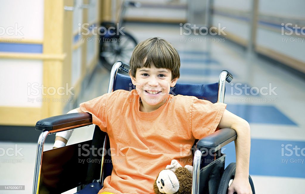 Little Boy in Wheelchair stock photo