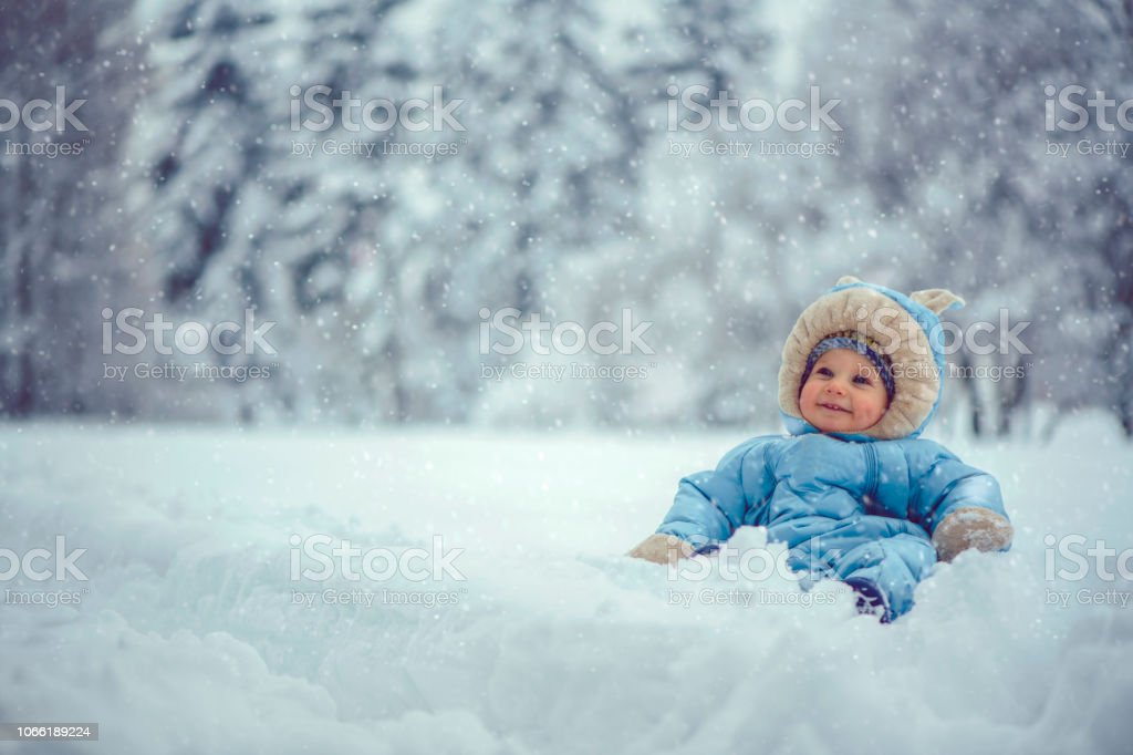 Little boy in winter park stock photo