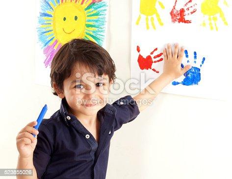 istock little boy is doing paint 523855026