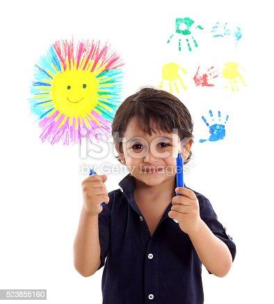 istock little boy is doing paint 523855160