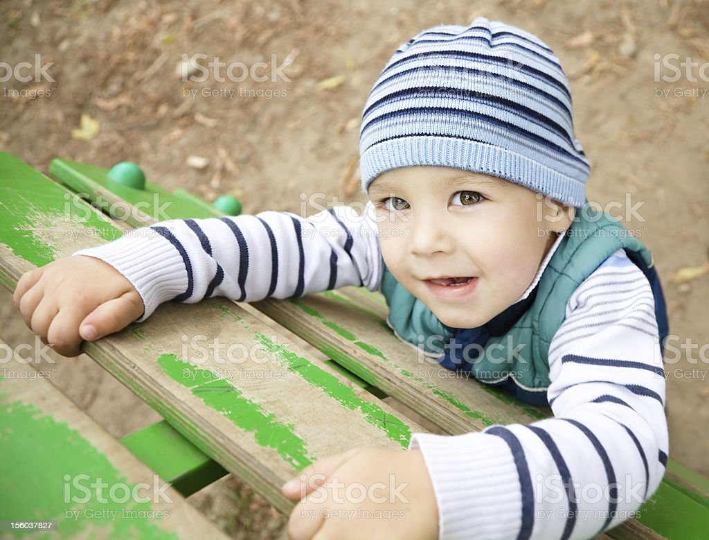 Little boy is playing on playground royalty-free stock photo