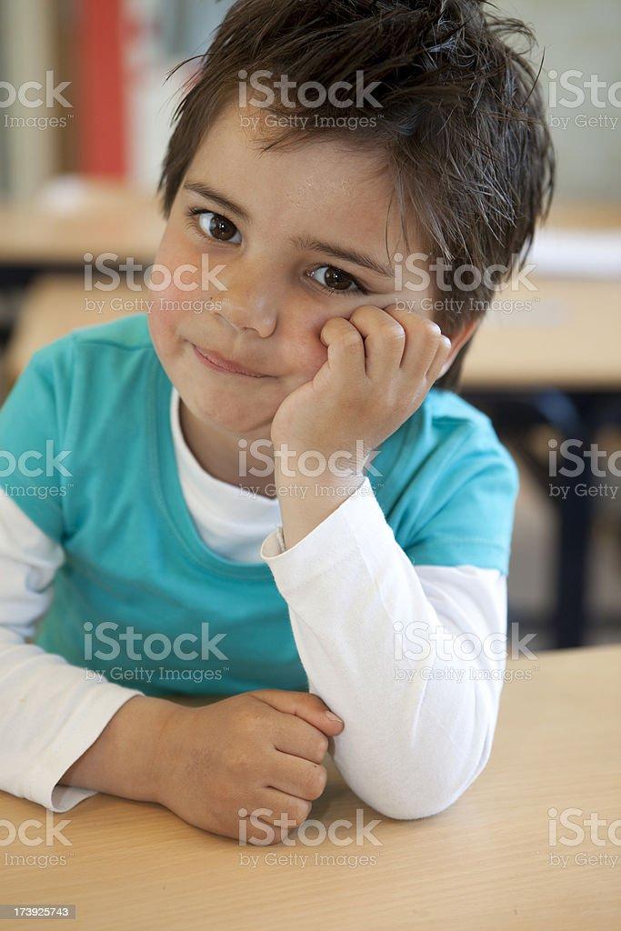 Little boy is posing in his Kindergarten classroom. royalty-free stock photo