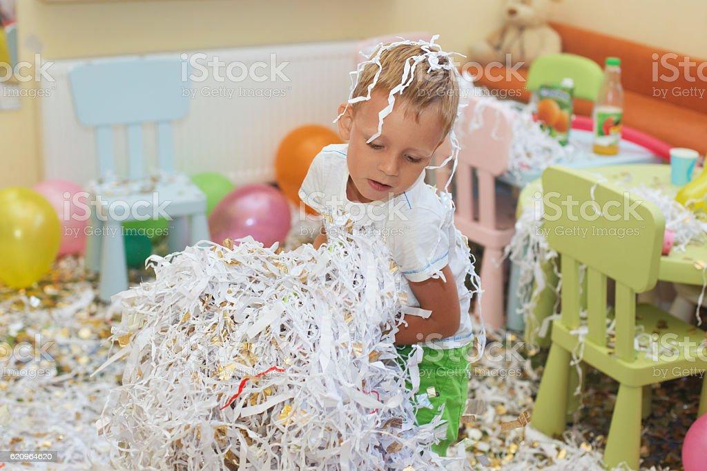 Little boy jumping and having fun celebrating birthday stock photo