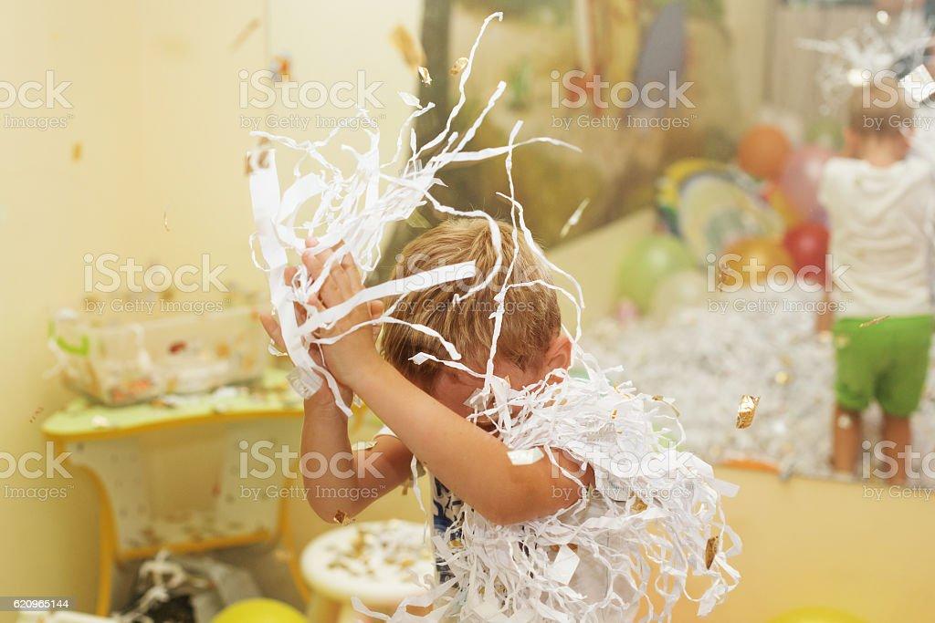 Little boy jumping and having fun celebrating birthday. stock photo