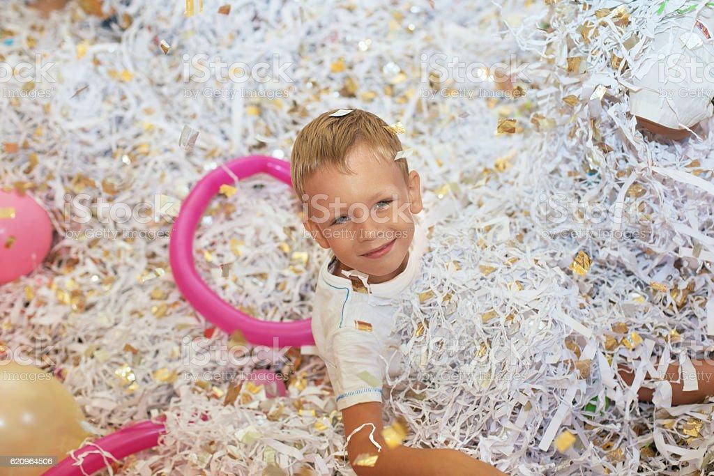 Little boy jumping and having fun celebrating birthday. Portrait stock photo