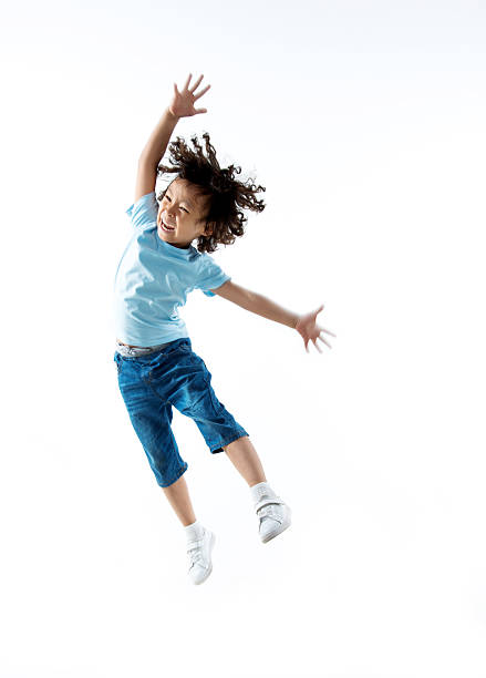 Little boy jumping isolated on white background stock photo