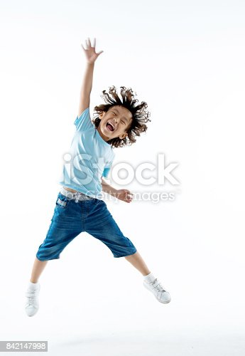istock Little boy jumping isolated on white background 842147998