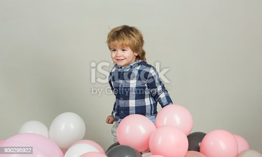 502282224 istock photo Little boy laughs and has fun, joy funny kid. Cute smile from young model. Decorations for children's photo session. Clothes for the youngest. Kid model wears clothes for advertising 930295922