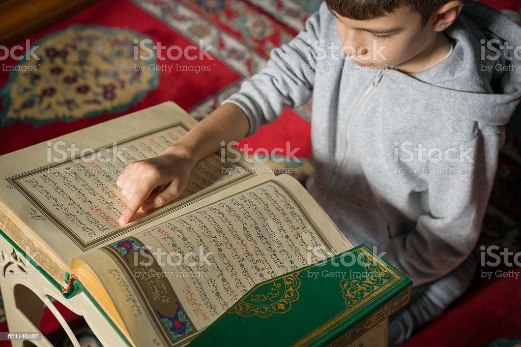 little boy learn Quran in mosque stock photo