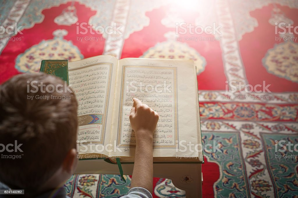 little boy learn Quran stock photo