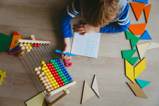 little boy learn to write and calculate numbers little boy learn to write and calculate numbers, math class learning difficulty stock pictures, royalty-free photos & images