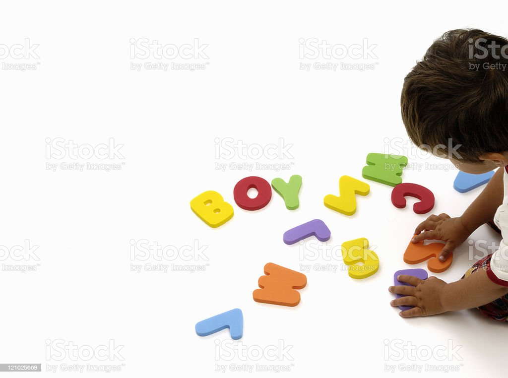 Little boy learning letters and numbers on white royalty-free stock photo
