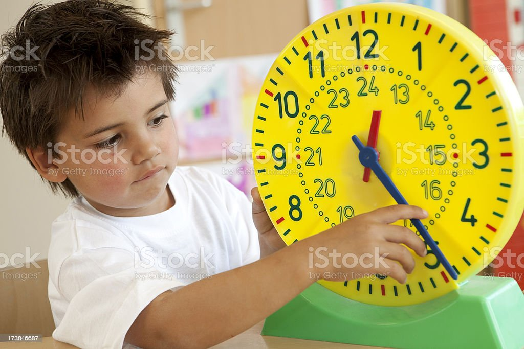 Little boy learning the clock royalty-free stock photo