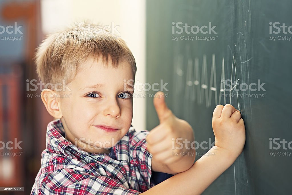Little boy learning to write royalty-free stock photo