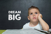 Little boy like a Businessman with text DREAM BIG