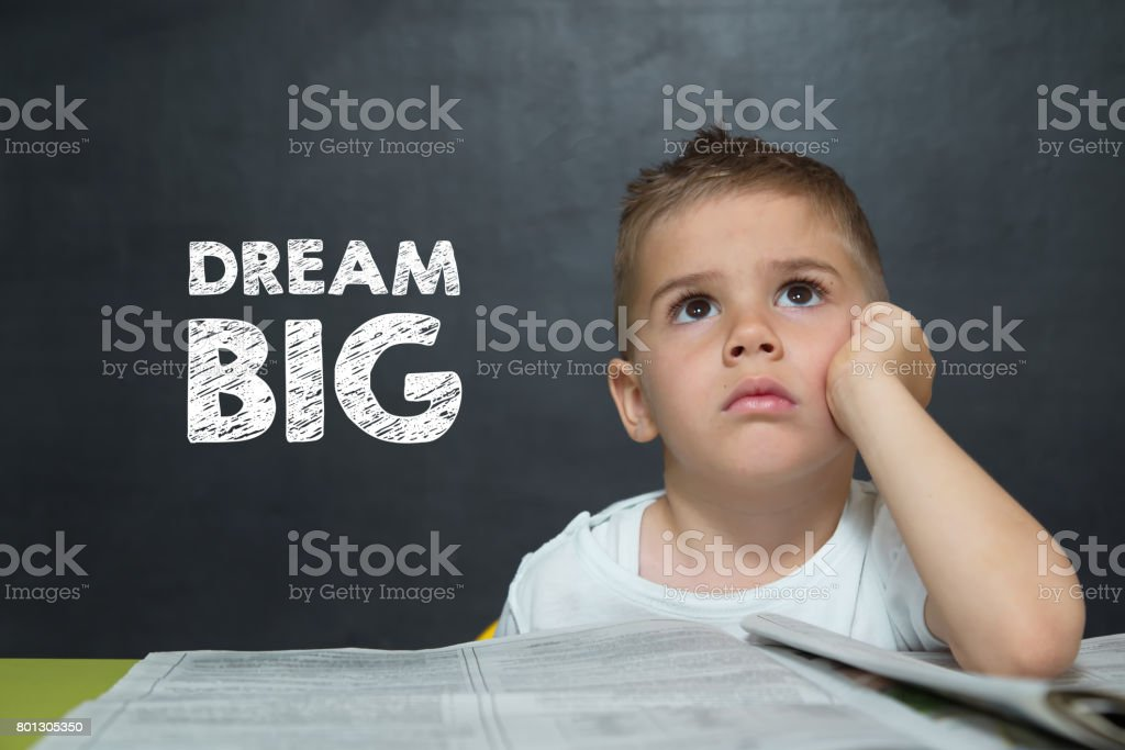 Little boy like a Businessman with text DREAM BIG stock photo