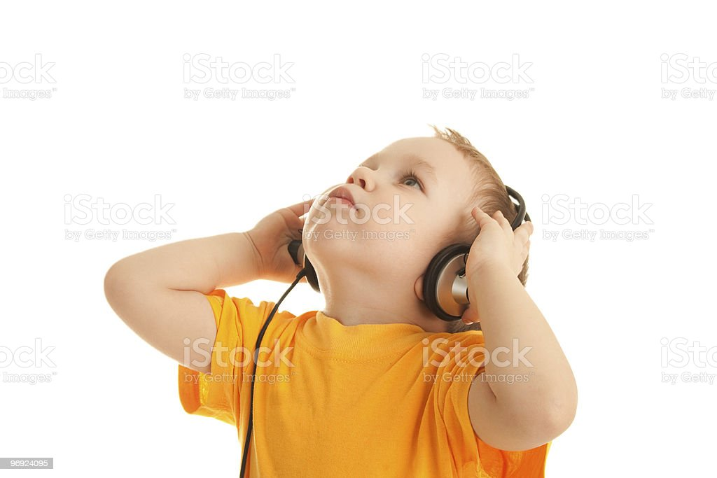 Little boy listening to music royalty-free stock photo