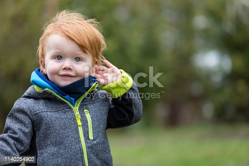 Little Boy Listening to Nature Sounds Outdoors