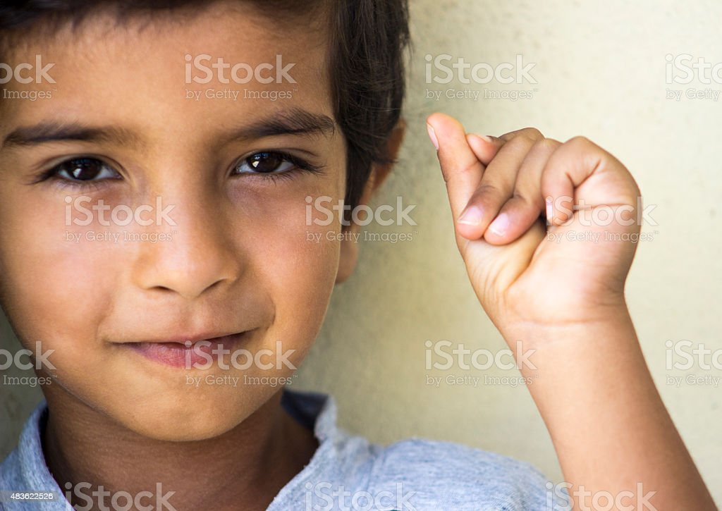Little boy looking at camera and snapping fingers stock photo