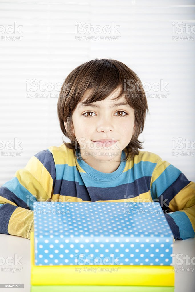 Little Boy Looking at Camera with Books royalty-free stock photo