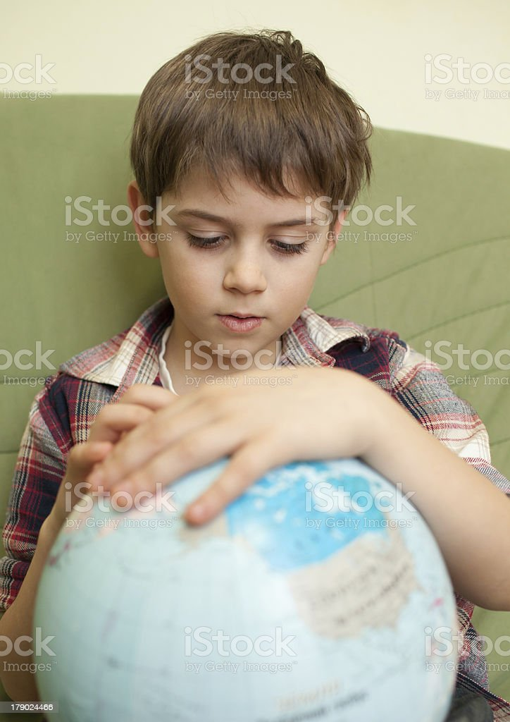Little boy looking at globe royalty-free stock photo