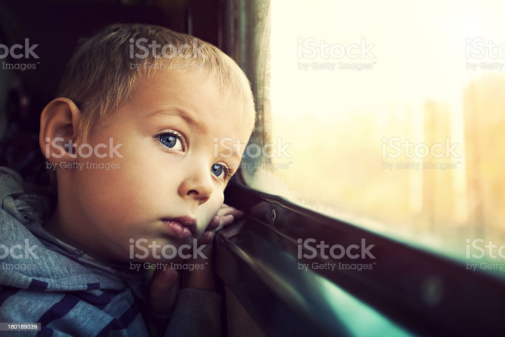 Little Boy Looking out of a window train royalty-free stock photo