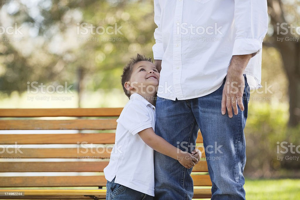 Little Boy Looking Up At Father In Park royalty-free stock photo
