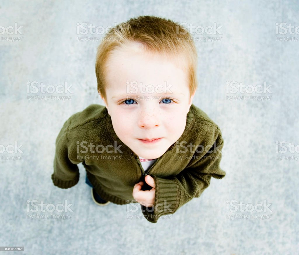 Little boy looking up at the camera royalty-free stock photo