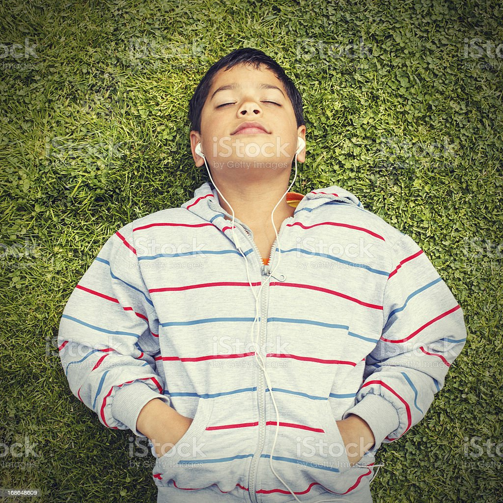 little boy lying on the grass royalty-free stock photo