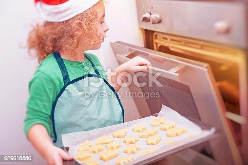 494086690istockphoto Little boy making Christmas cookies 629615556