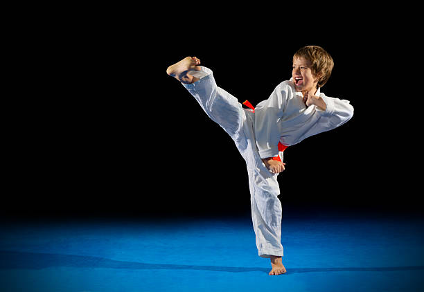little boy martial arts fighter - karate stock-fotos und bilder