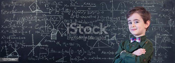 Little Boy Mathematics Formula on Chalkboard