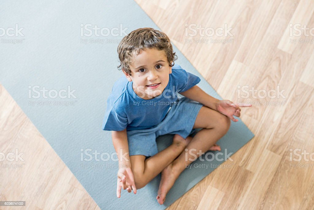 Little Boy Meditating on His Mat stock photo