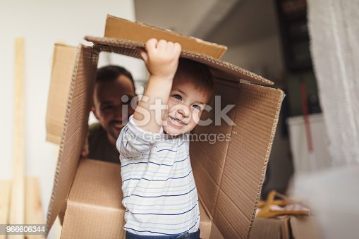 istock Little boy moving into his new home 966606344