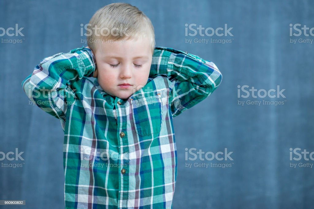 Little boy not listening stock photo