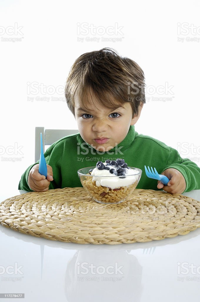 Little boy not wanting to eat his healthy meal. royalty-free stock photo