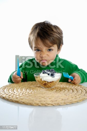 istock Little boy not wanting to eat his healthy meal. 117279477