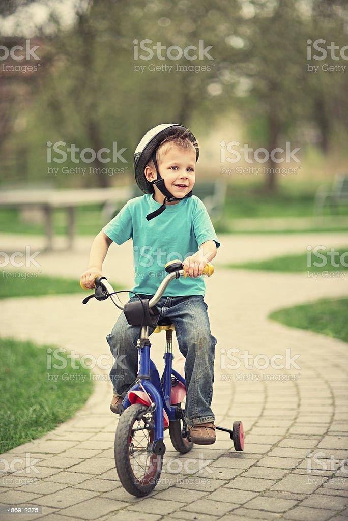 Little boy on his bike. stock photo