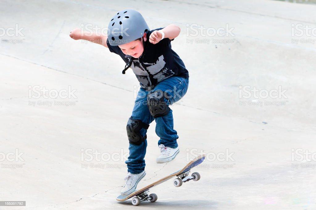 Little boy on his skateboard stock photo
