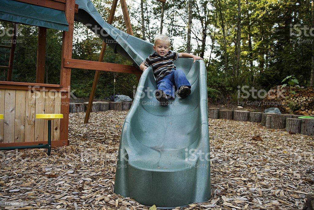 Little boy on his slidingboard royalty-free stock photo