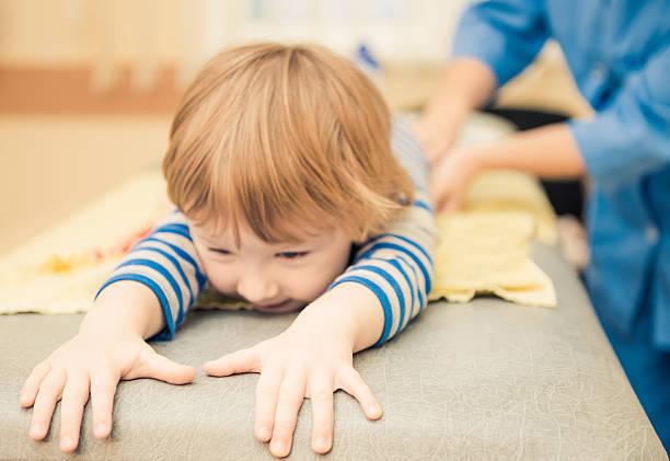 little boy on massage table stock photo